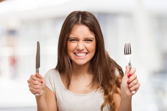 happy-woman-wiht-knife-and-fork-1024x683